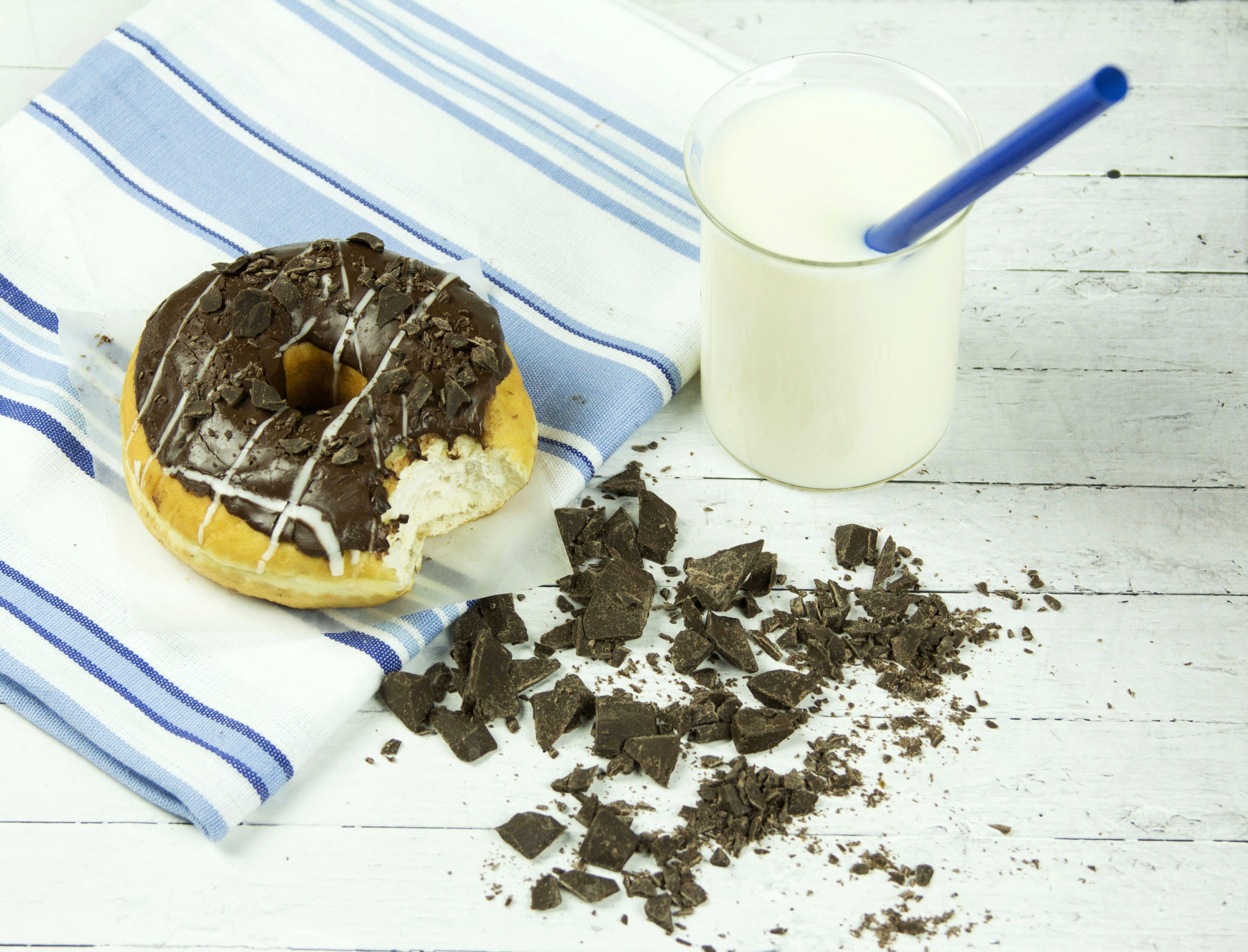 Chocolate Donut Beside Chunked Chocolates