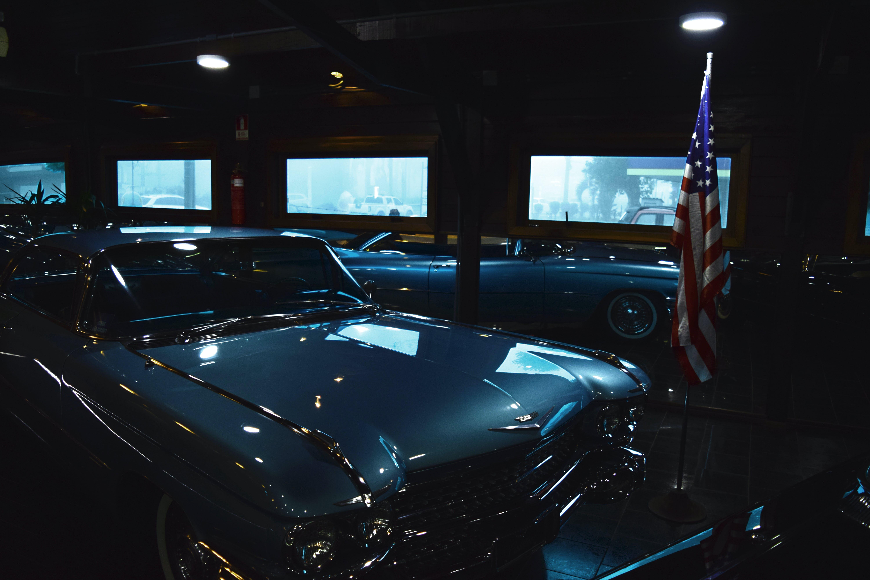 Classic Gray Chevrolet Car Near Us Flag Inside Garage