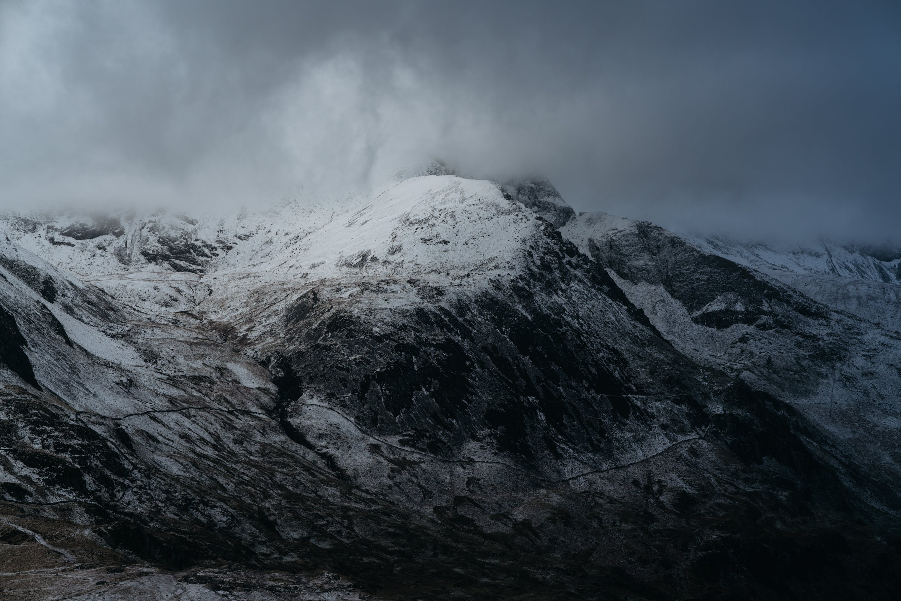 Snow-coned Mountain Under Cloudy Sky