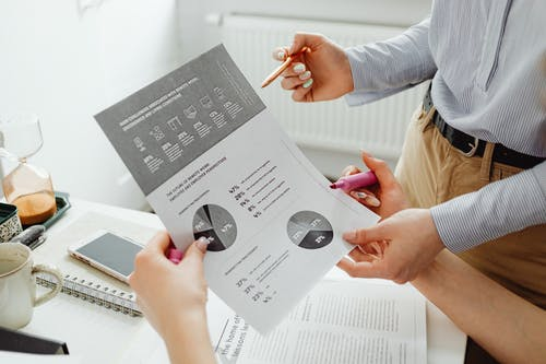 Close-Up Photo of Person Holding an Accounting Document