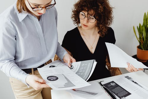 Two Women Doing Their Paperwork