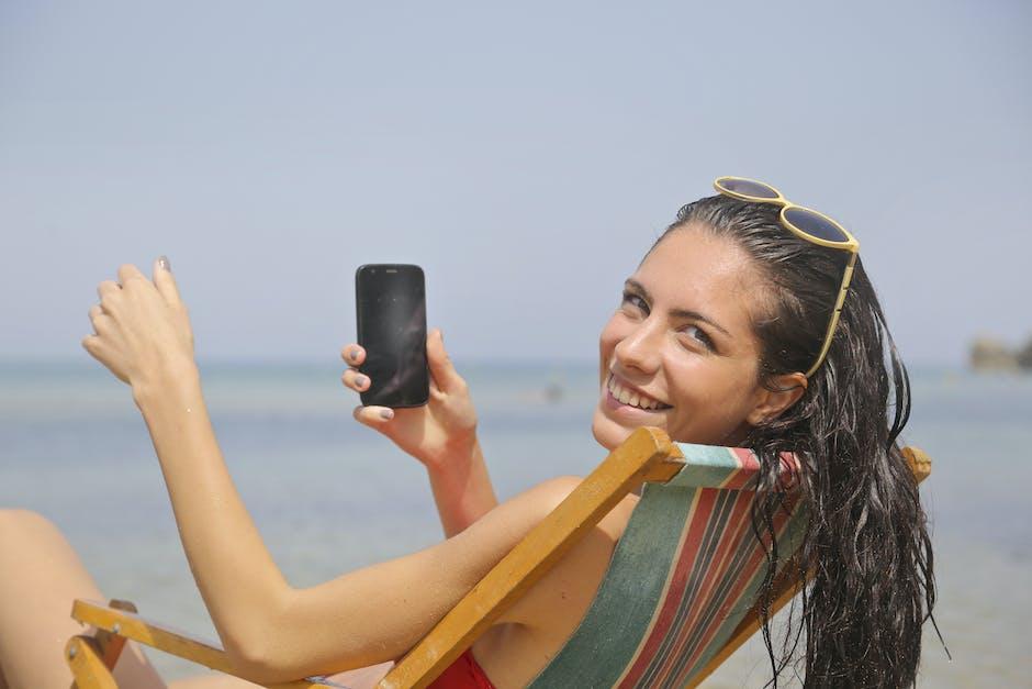 Woman sitting on sun lounger