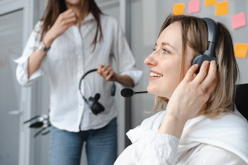 Close-Up Photo of Smiling Woman Wearing Headphones