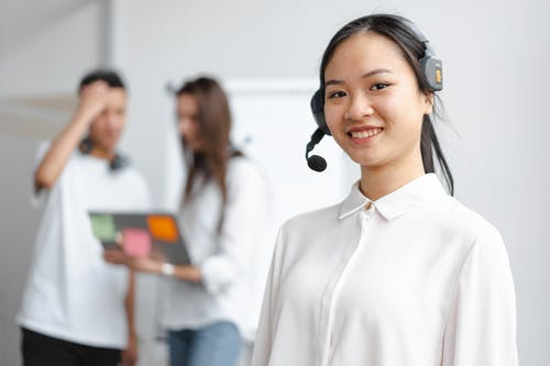 Shallow Focus Photo of Smiling Woman Wearing Headphones