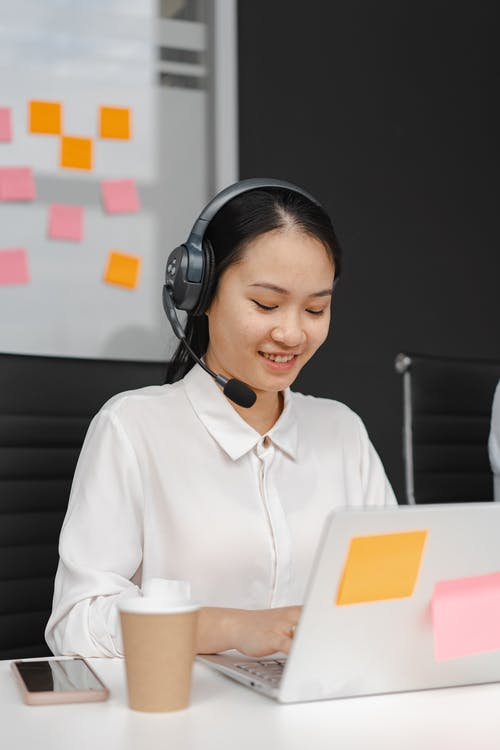 Woman Working as a Call Center Agent