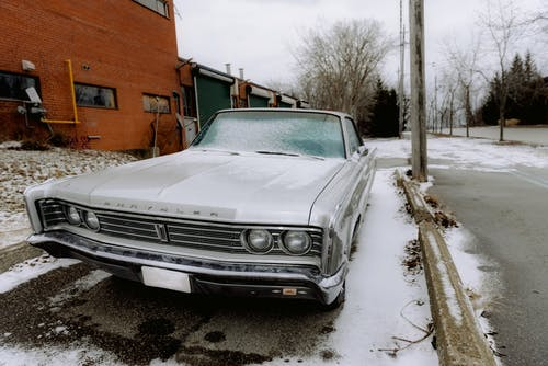 A White Vintage Car Parked Outside