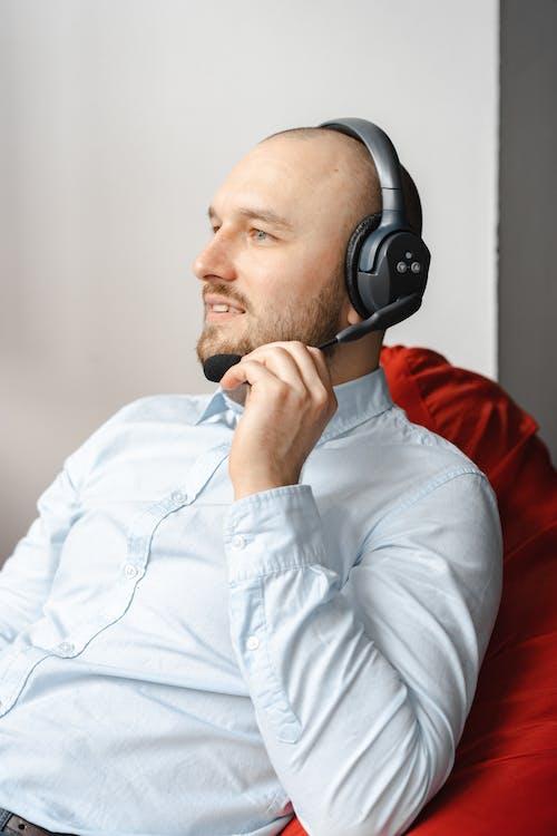 Photos gratuites de agent de centre d'appel, casque, casque d'écoute