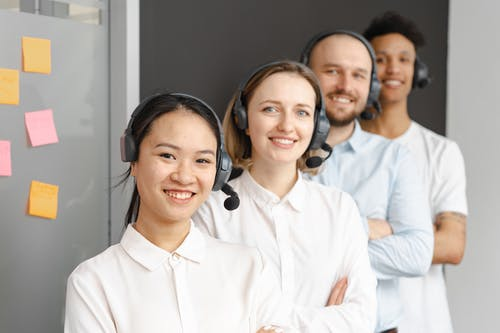 Smiling Call Center Agents Looking at Camera