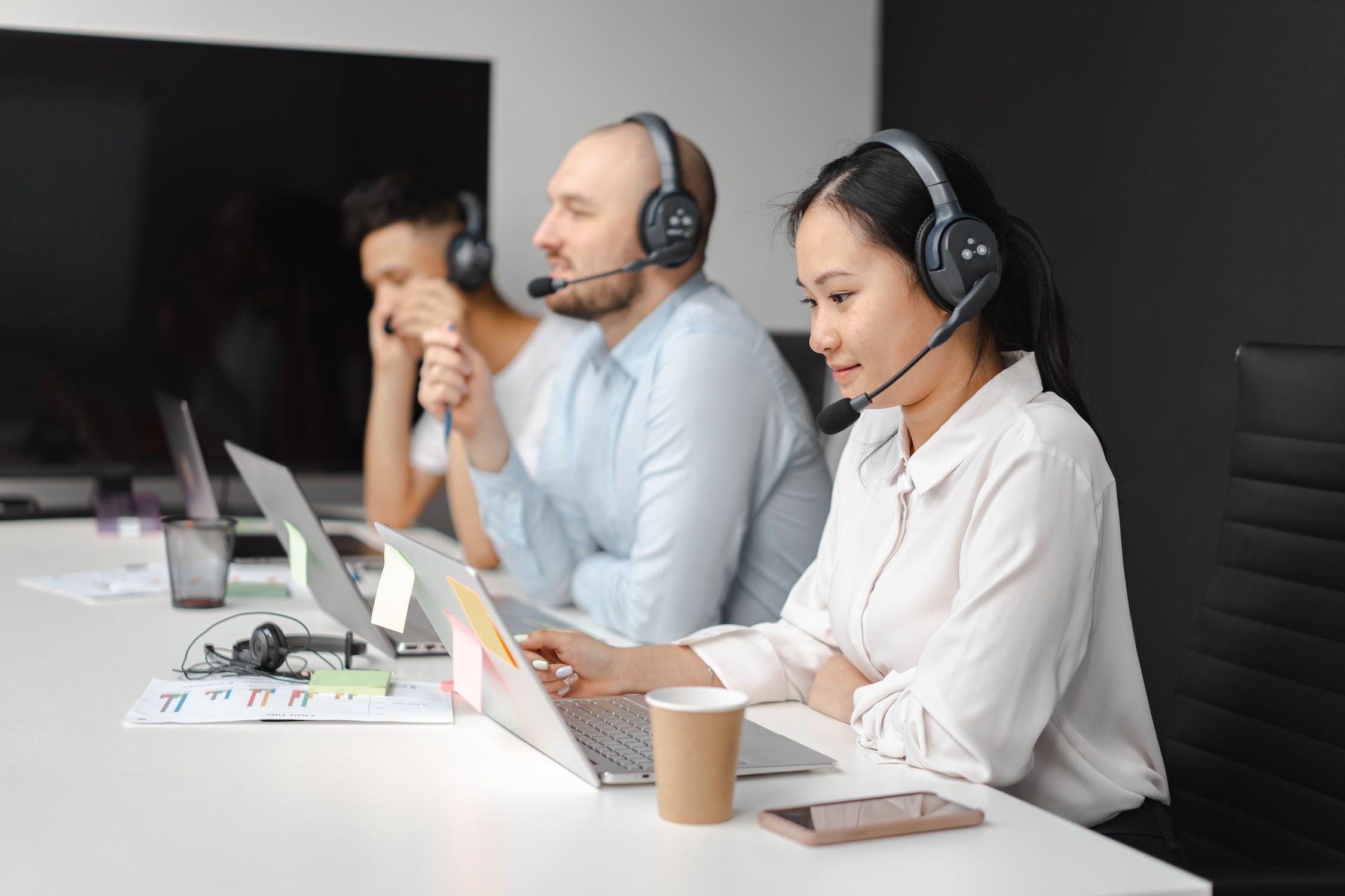 Three customer service representatives altering customer perception.