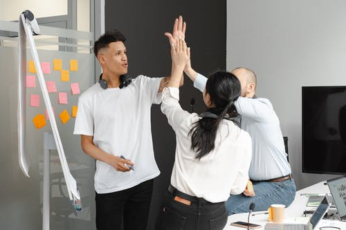 Colleagues Giving Each Other High Five