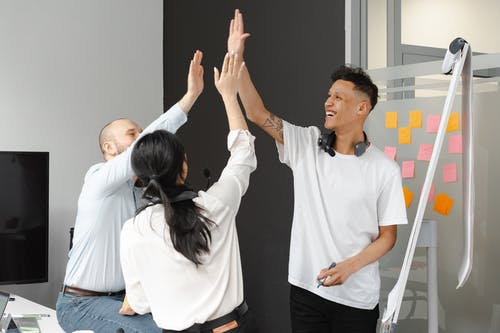 Happy People Doing High-Five