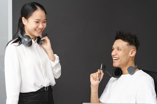A Man and a Woman Talking While at Work