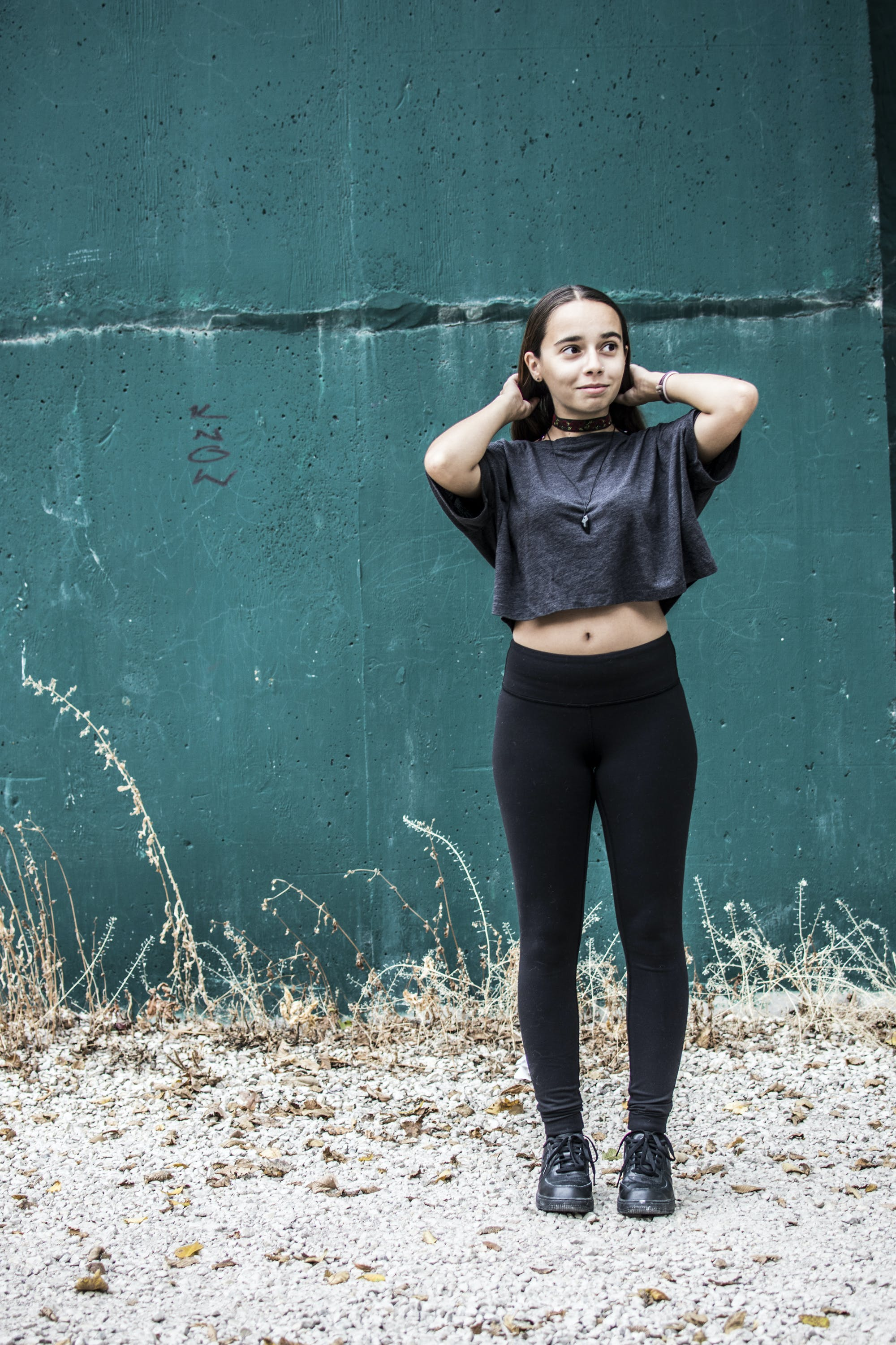 Woman Wearing Black Crew-neck Crop-top and Black High-waist Fitted Leggings