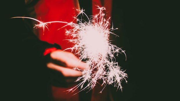Photo of a Person's Hand Holding Firecracker