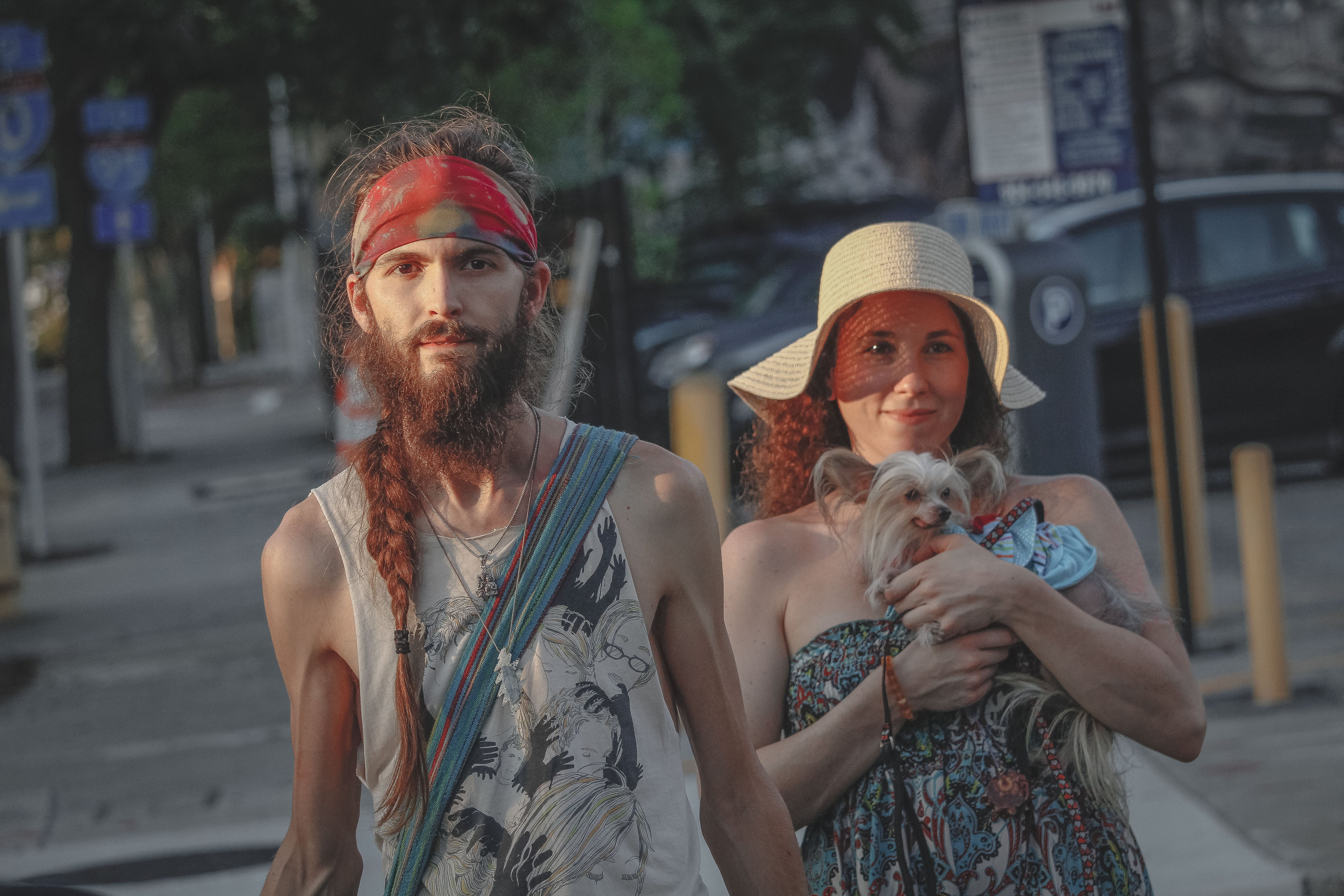 Man And Woman Standing On Sidewalk