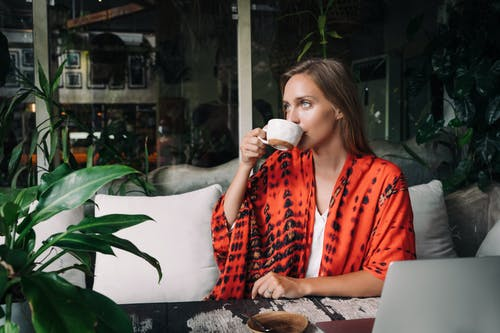 A Beautiful Woman Drinking from a Cup