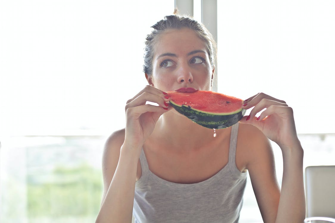 Woman in Gray Tank Top Holding Watermelon