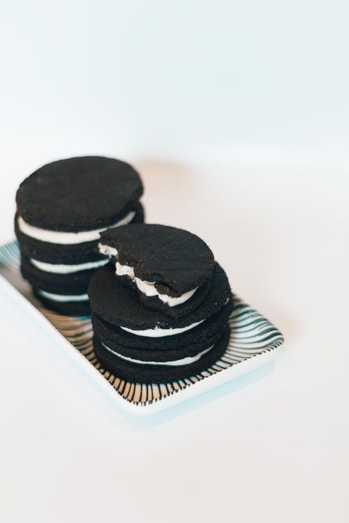 Black and White Cupcakes on White Ceramic Plate