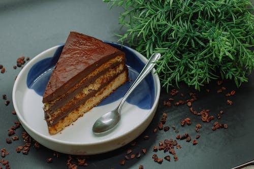 Sliced Chocolate Cake on White Ceramic Plate