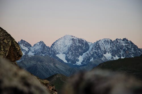 Picturesque mountainous valley covered with snow at sundown