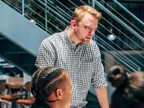 A Bearded Man Wearing a Checkered Shirt
