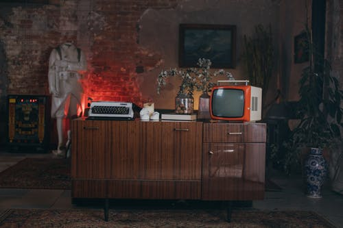 Brown Wooden Cabinet With Black and Silver Vintage Tv