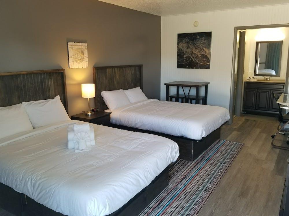 Foto profissional grátis de cama, dormitório, hotel