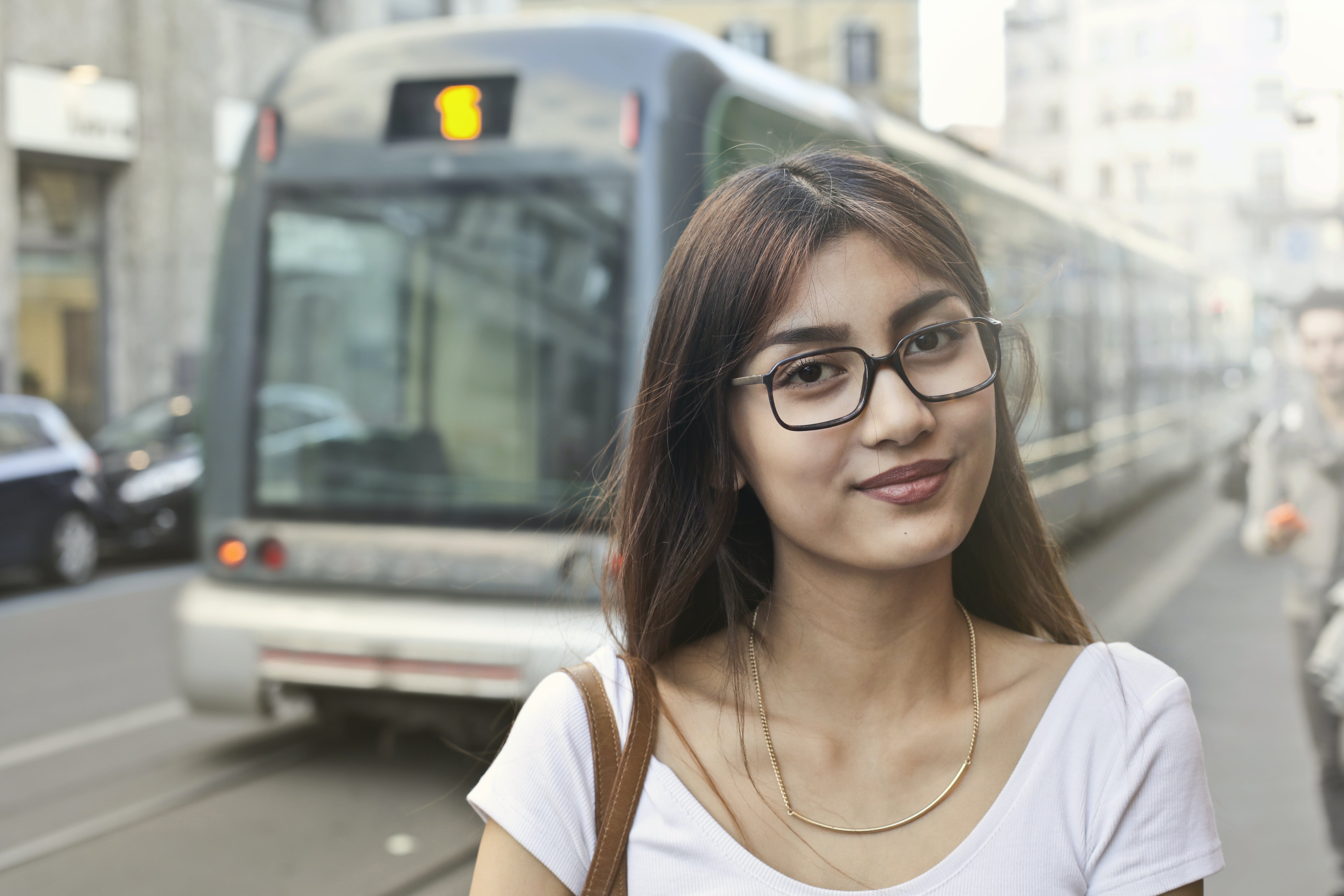 Woman in White Shirt With Eyeglasses Standing Near Train