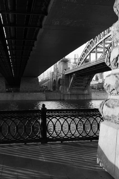 Grayscale Photo of Concrete Bridge