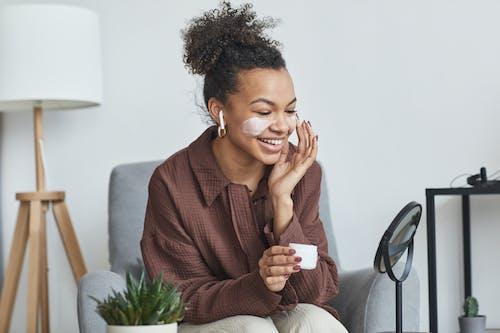 Woman in Brown Blazer Sitting on Gray Sofa