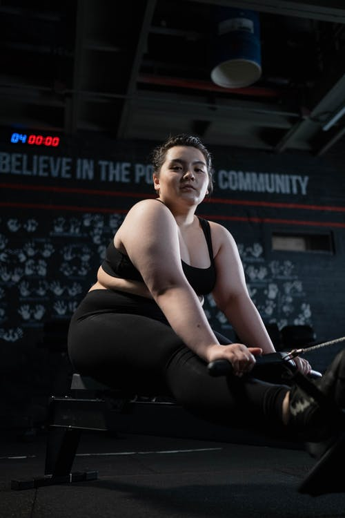 Woman in Black Tank Top and Black Leggings Doing Exercise