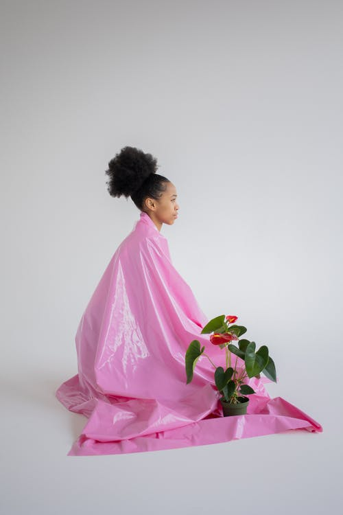 A Woman Covered in a Pink Plastic