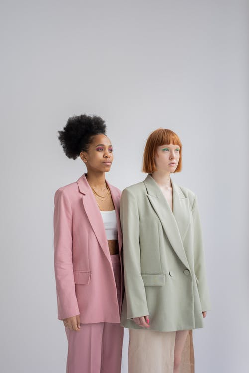 Unemotional multiracial women in stylish blazers