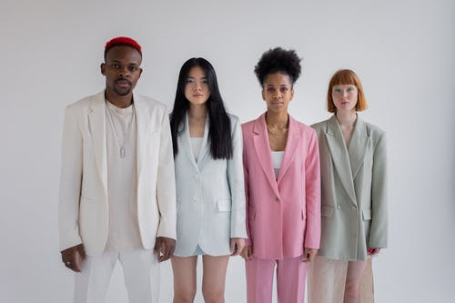 Multiethnic unemotional models in stylish outfits