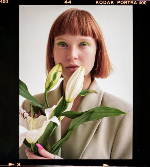 Woman with blooming fresh lilies in film frame