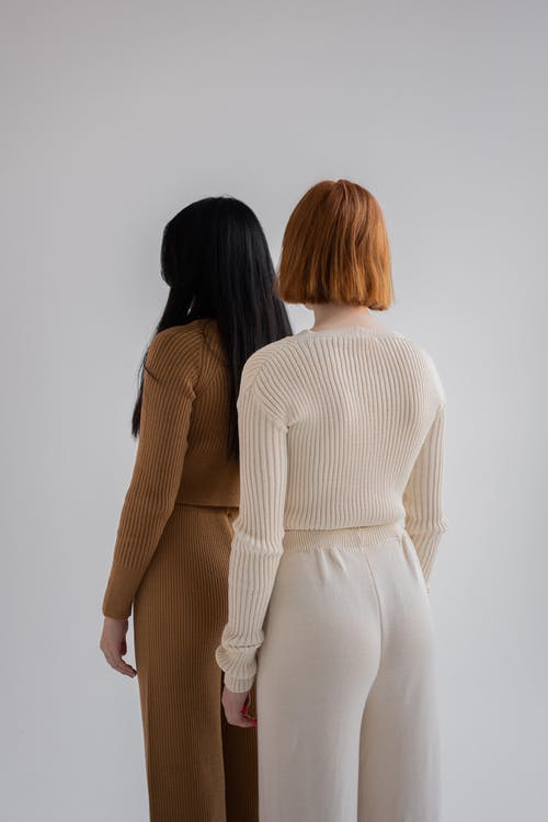 Women dressed in knitted sweaters and pants in studio