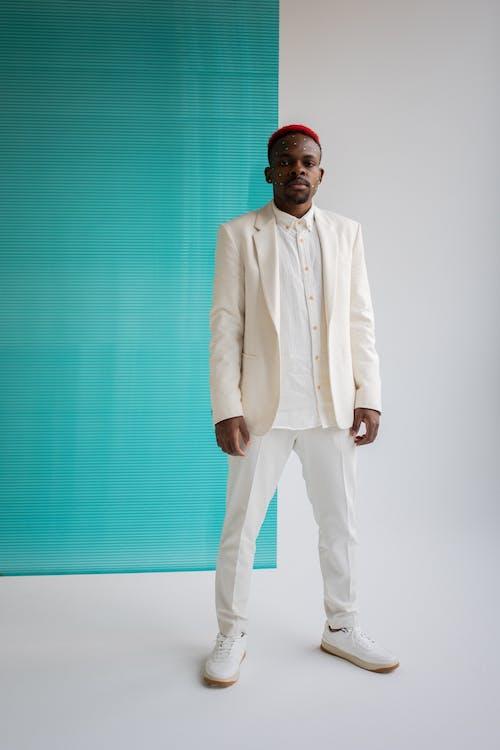 Stylish black man in white suit
