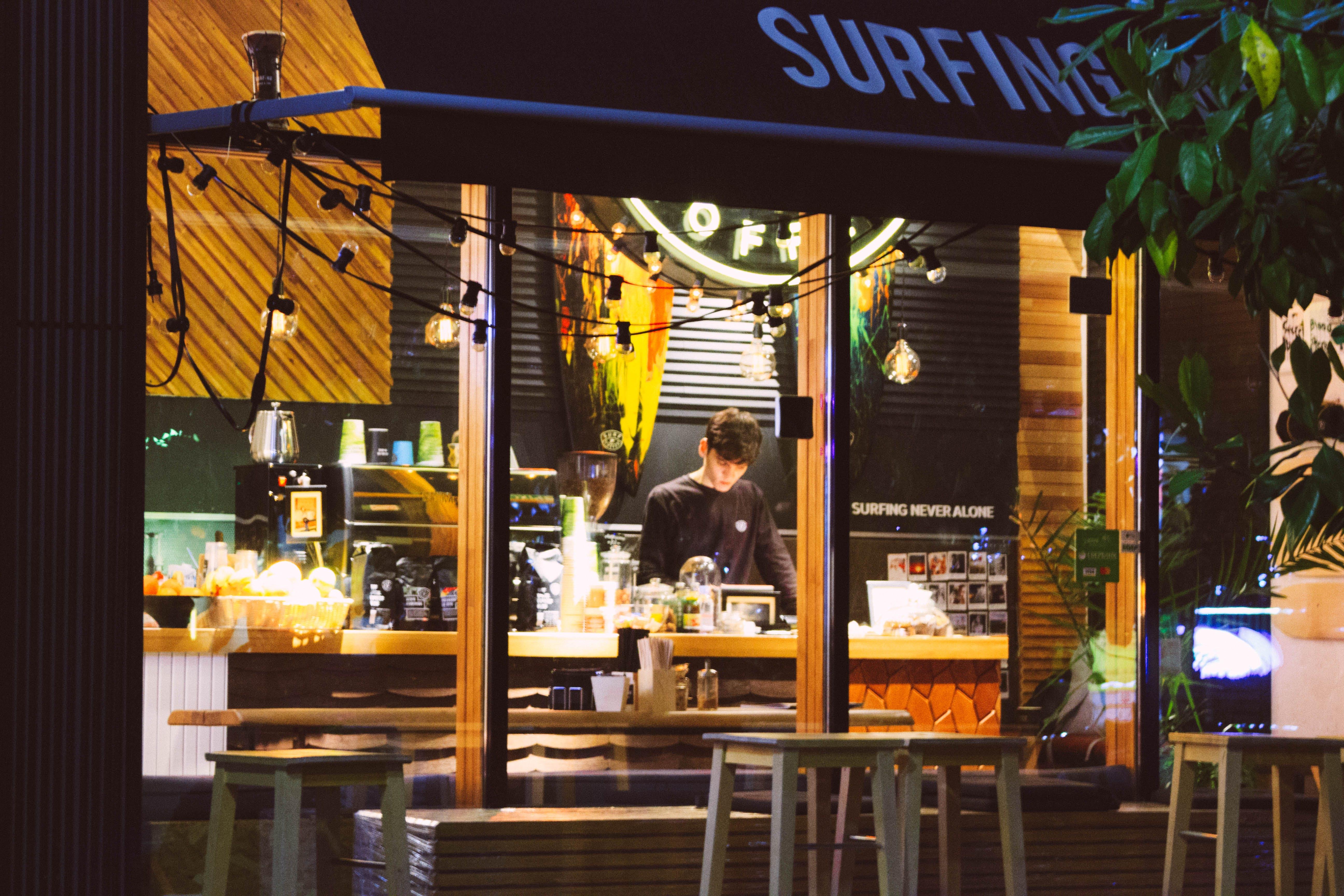 Man Wearing Black Hoodie Standing Near Countertop