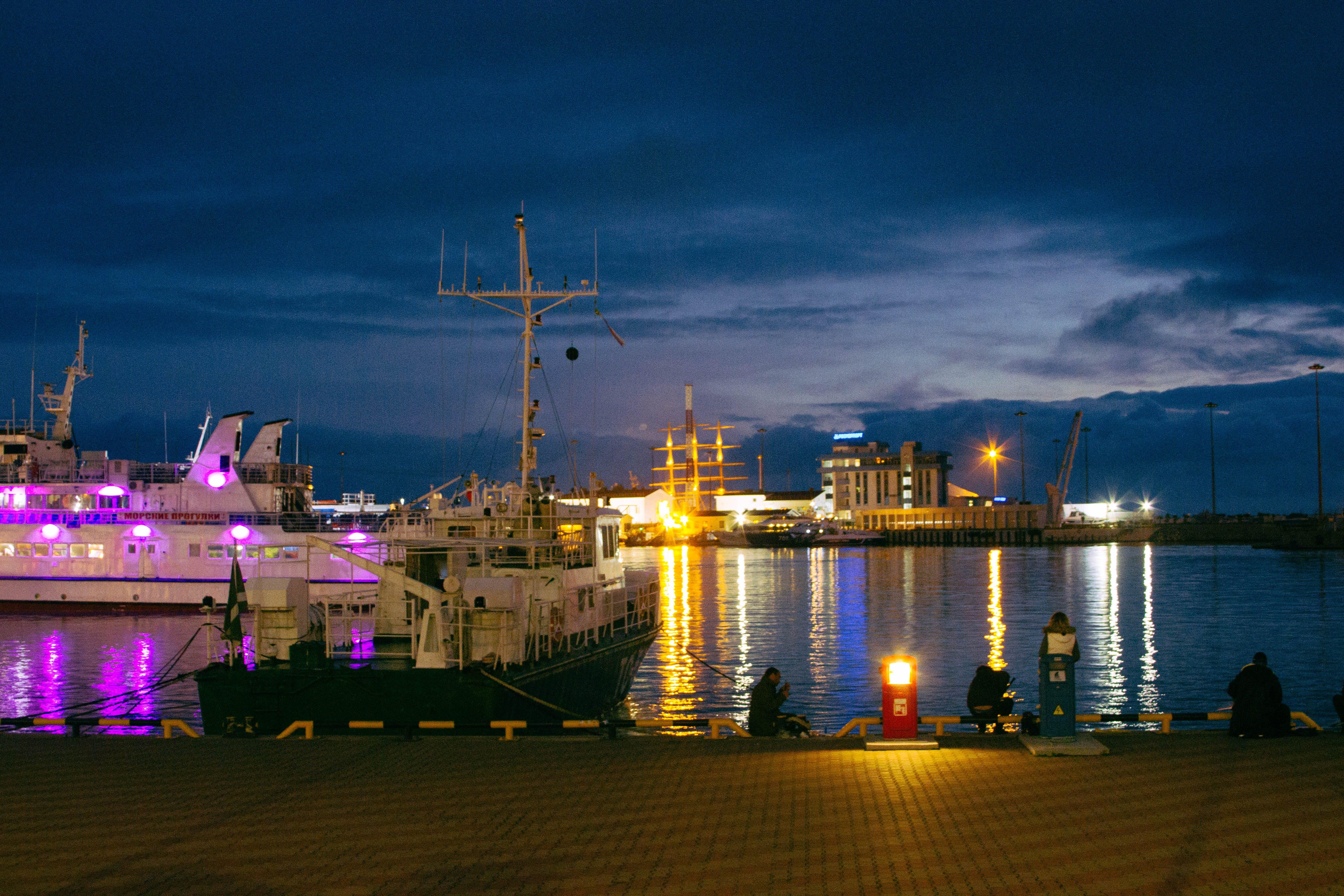 White Boat Near Dock during Nighttime