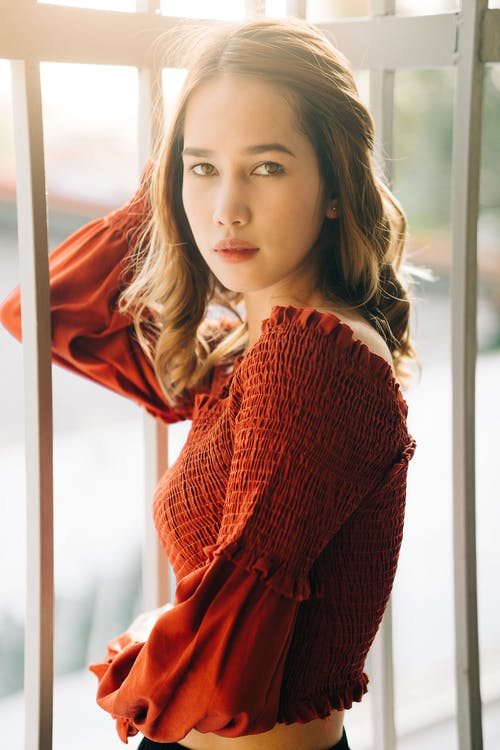 Woman in Red Knit Sweater