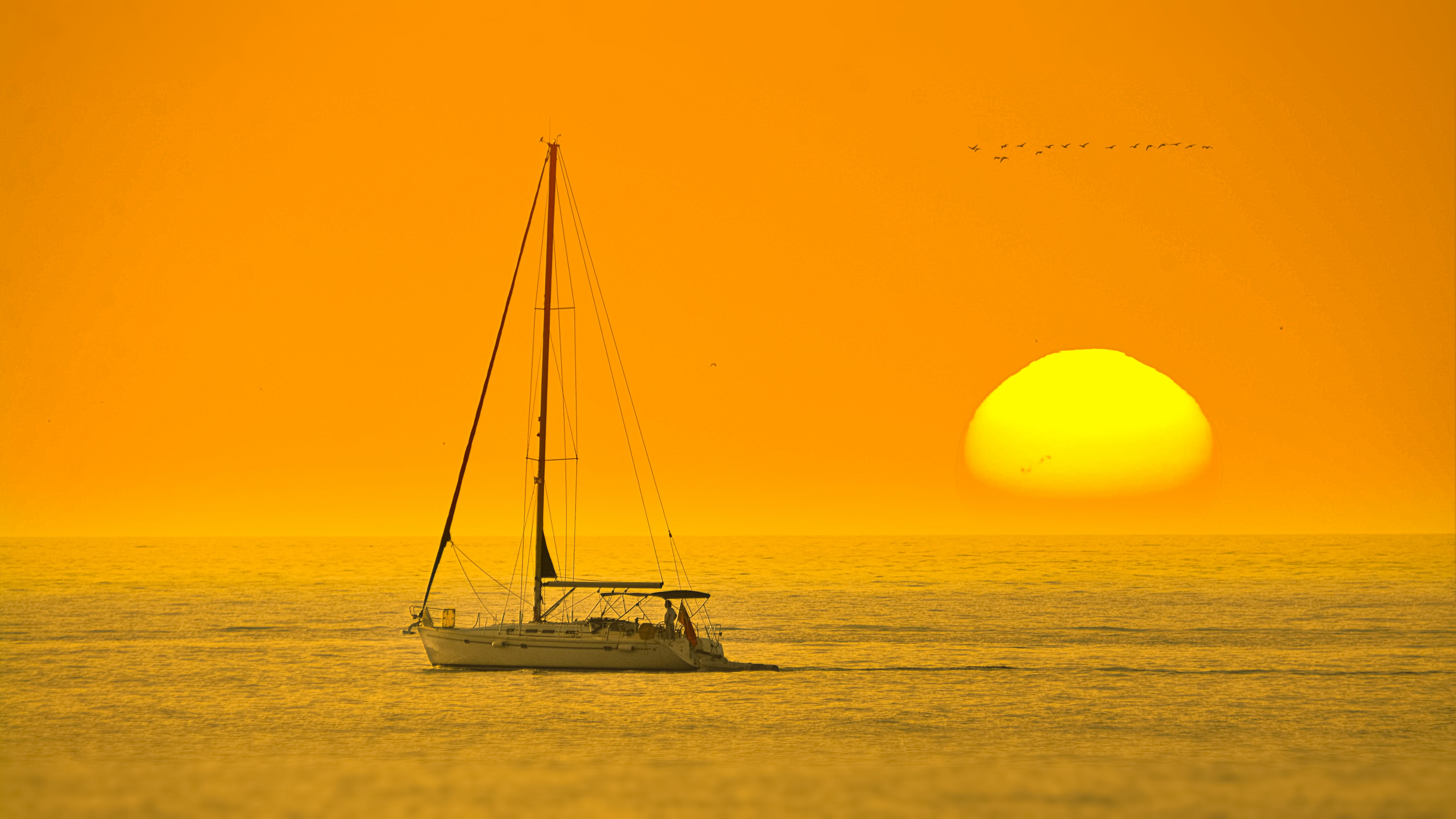 White Boat In The Middle Of The Sea During Sunset
