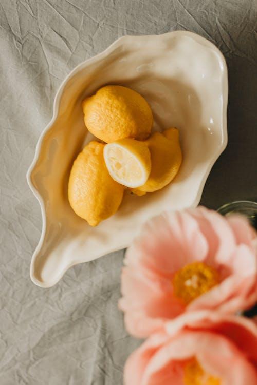 Sliced Lemon on White Ceramic Bowl
