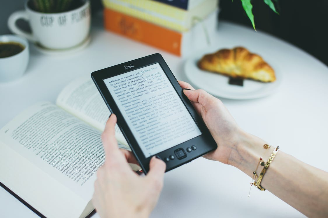 Person Holding Kindle E-book Reader