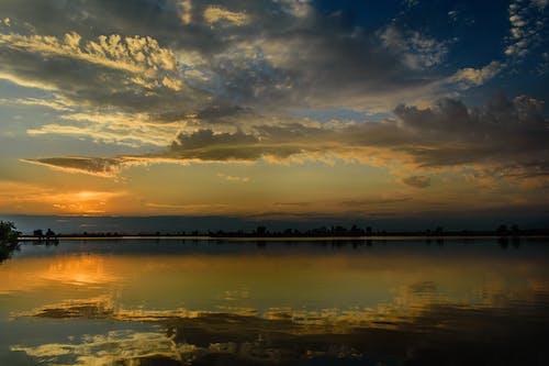 Kostnadsfri bild av damm, färg, gyllene timmen, himmel