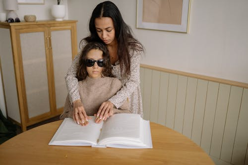 A Woman Reading Braille