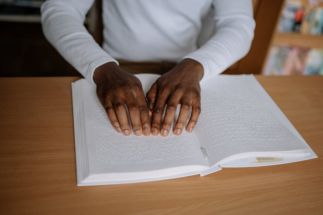 Person in White Long Sleeve Shirt Holding White Paper