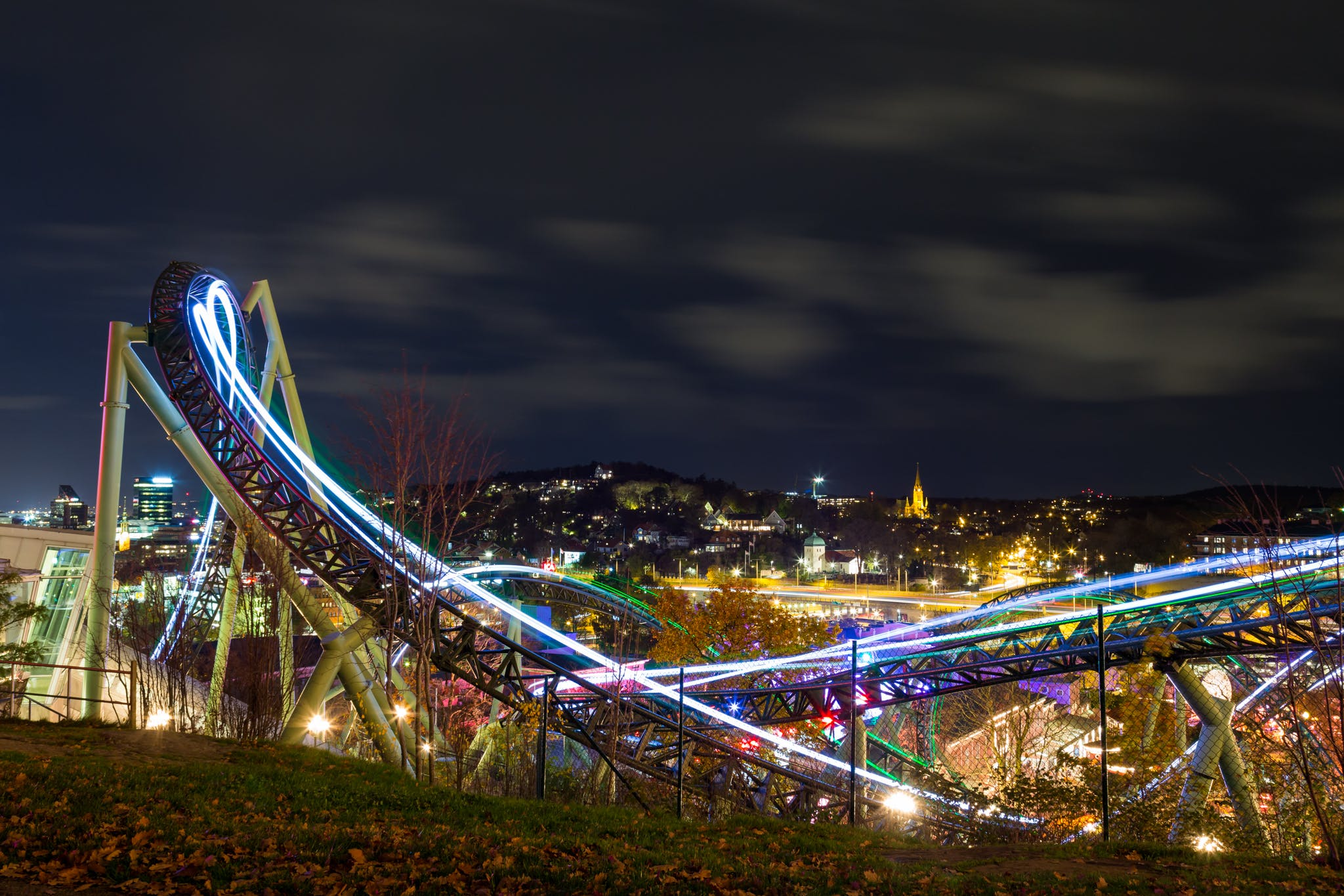 Time-lapse Photography Of Roller Coaster During Night Time
