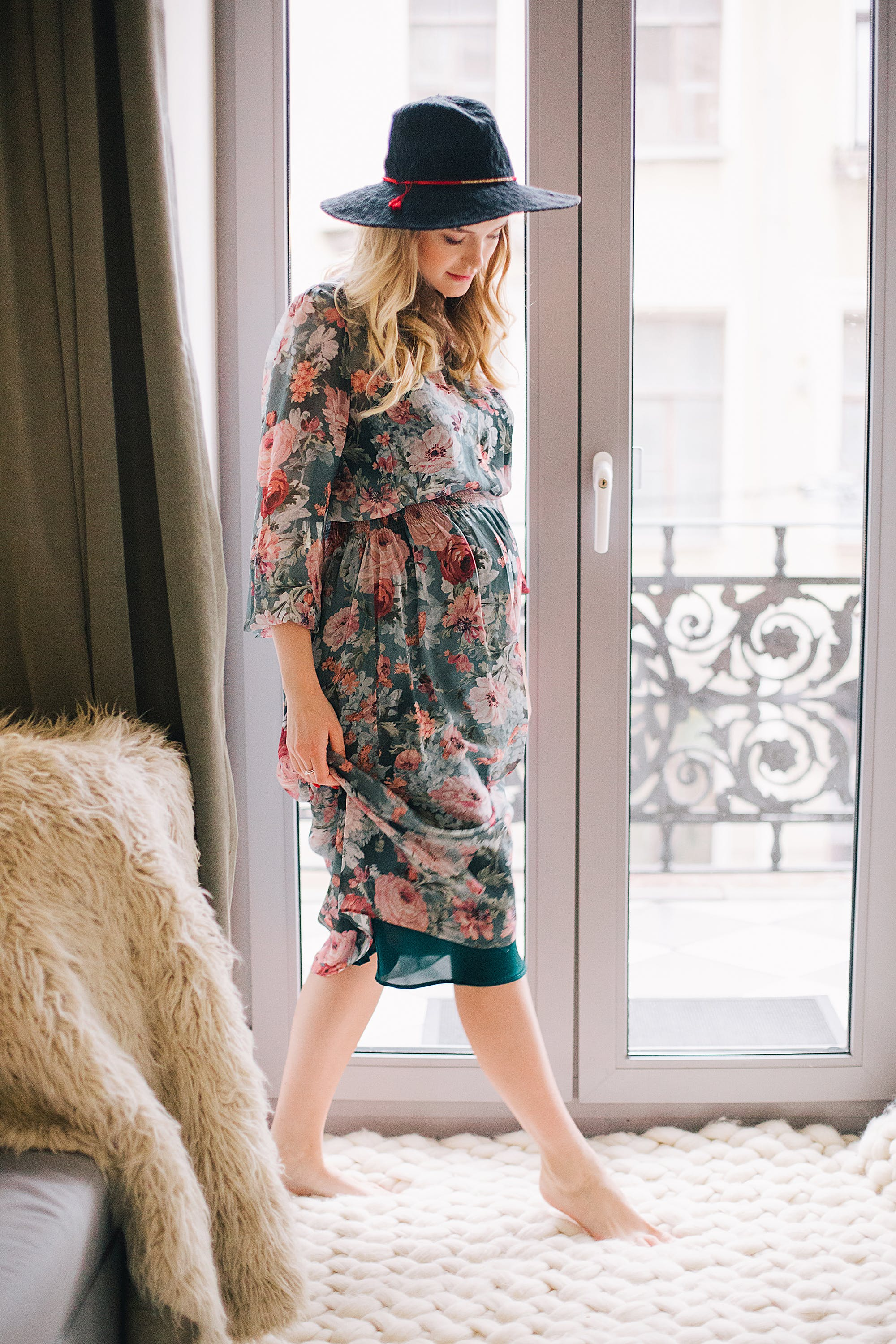 Woman in Black, Pink, and Red Floral Long-sleeve Dress