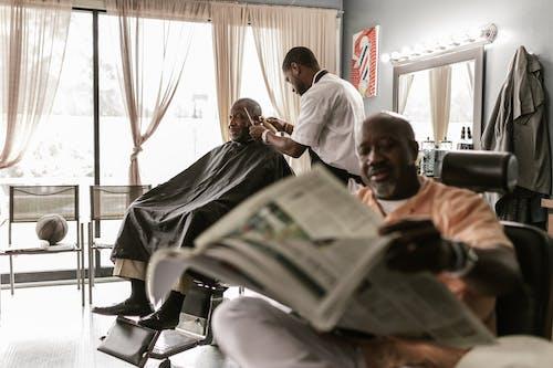 Man in White Dress Shirt Cutting Mans Hair