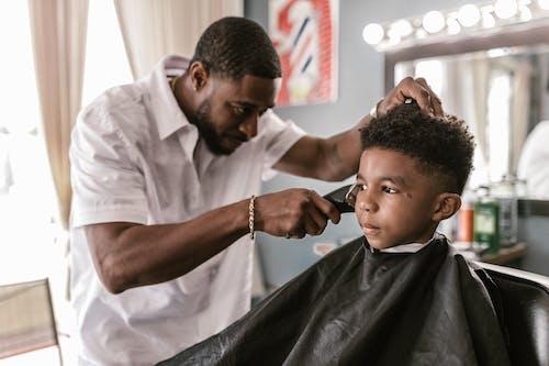 Man in White Shirt Cutting Hair of Man